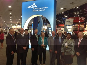 AGA executives pose with distinguished leaders at the AGA Welcome Booth.