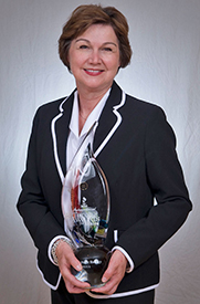 CenterPoint Energy Community Relations Director Jean Krause accepts the BBB International Torch Award for Ethics. Image courtesy of CenterPoint Energy.